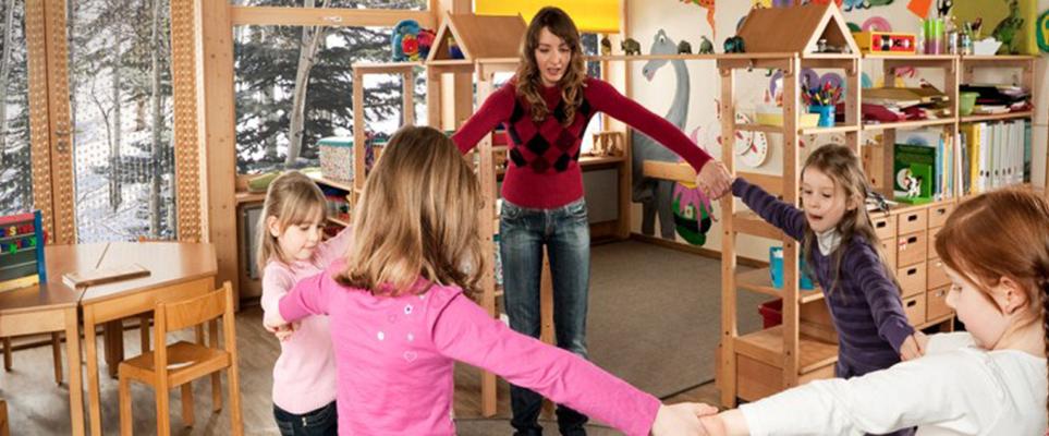 Woman with kids at ski lodge