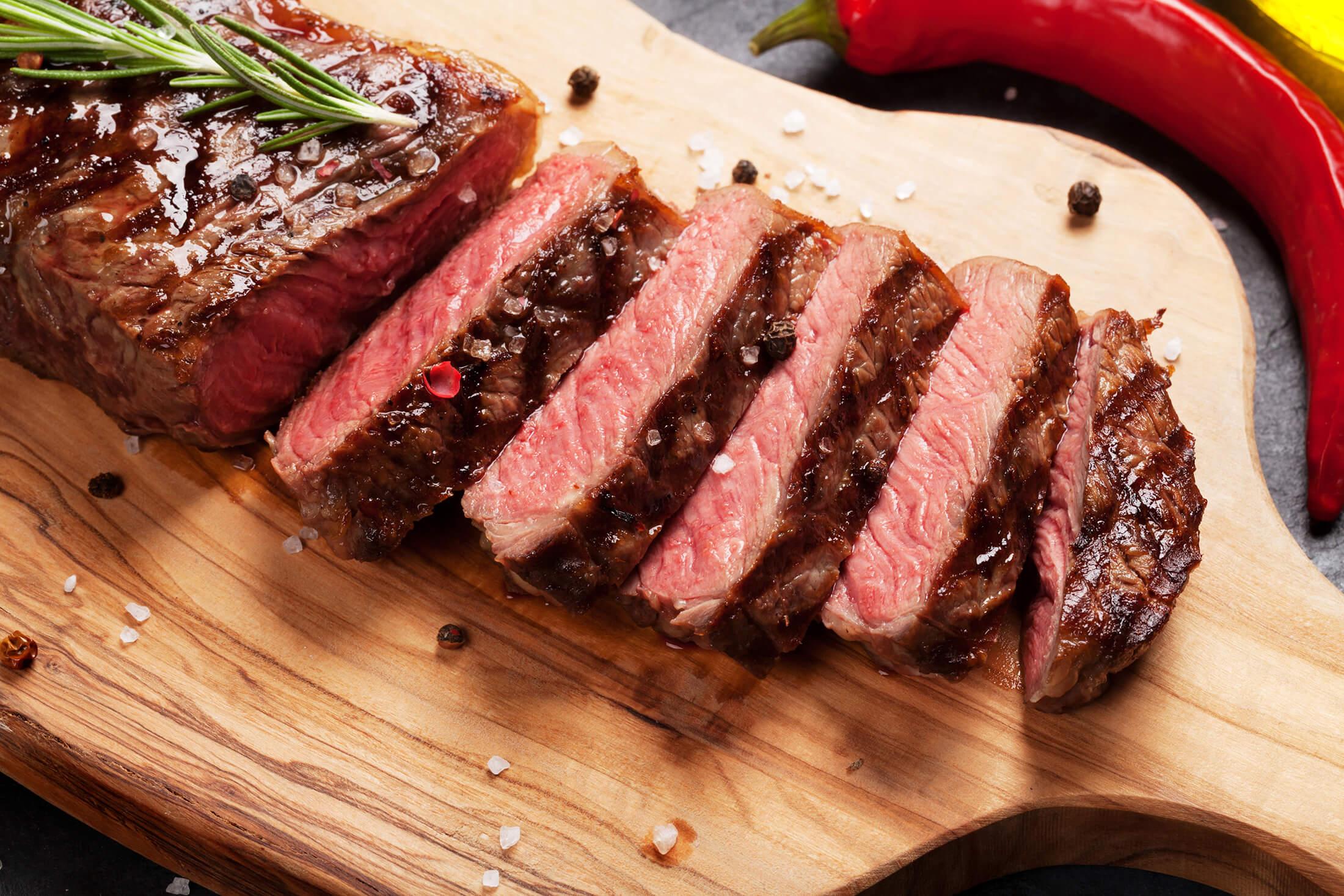 A steak on a wooden board