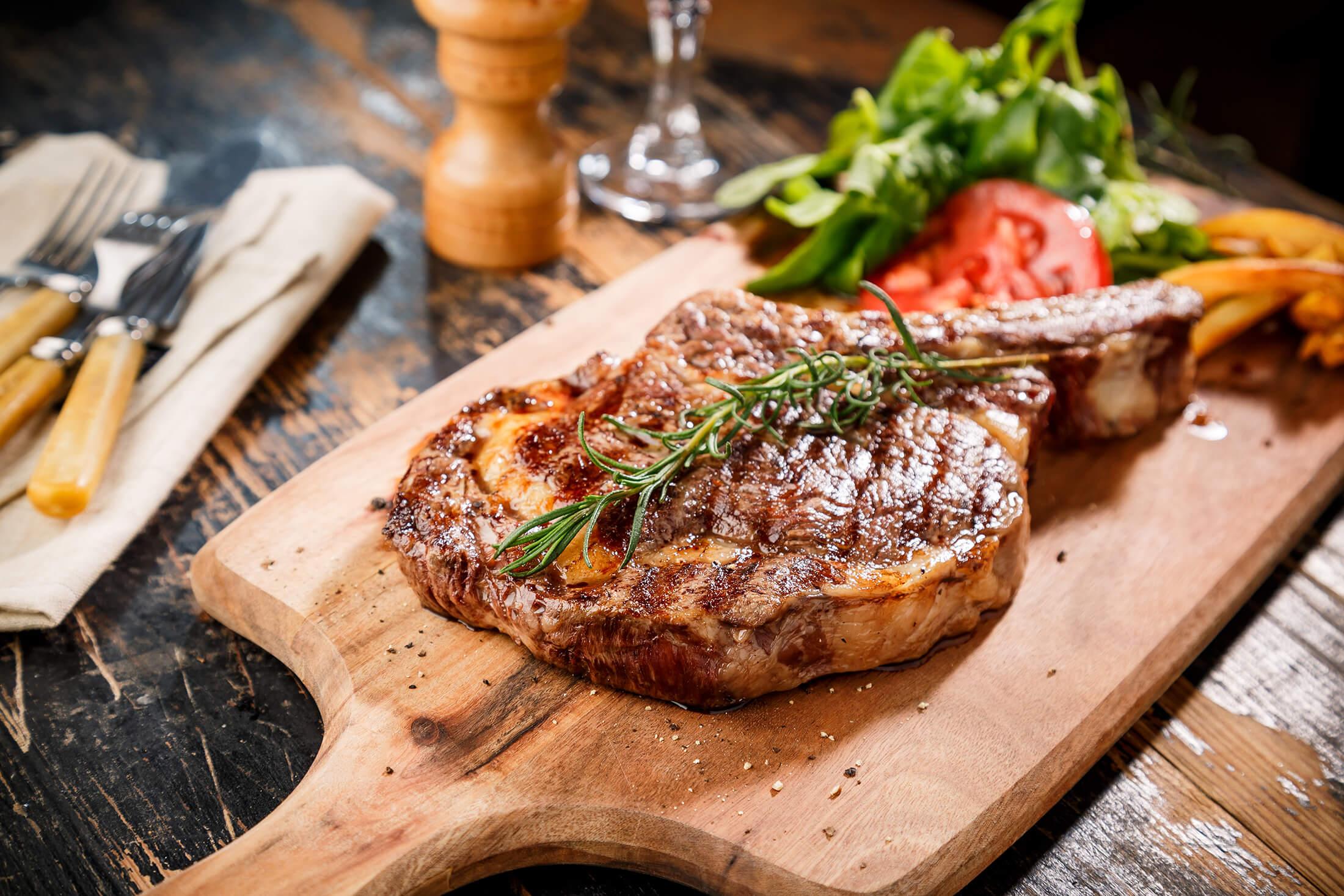 Steak on a wooden platter