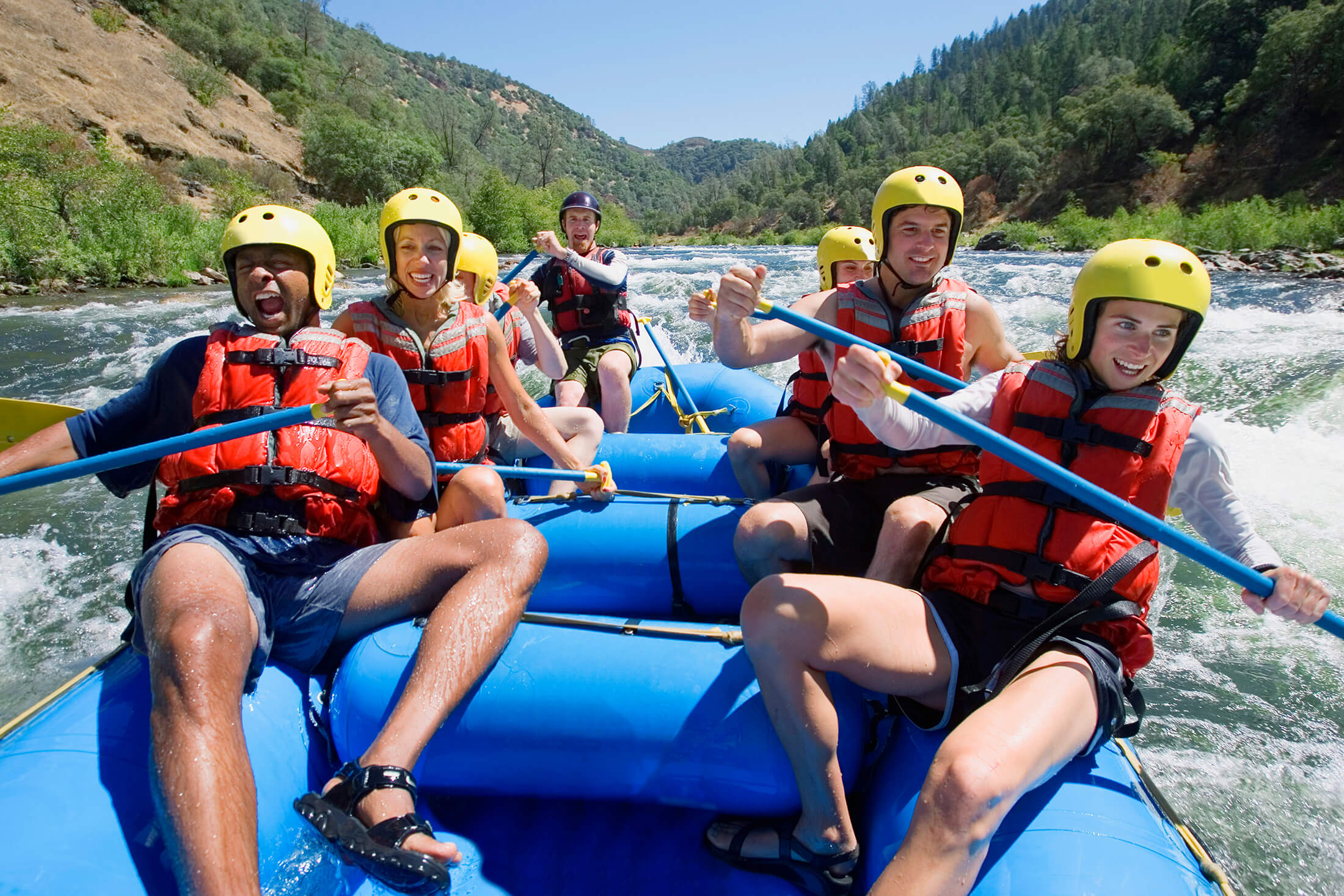 People in white water raft