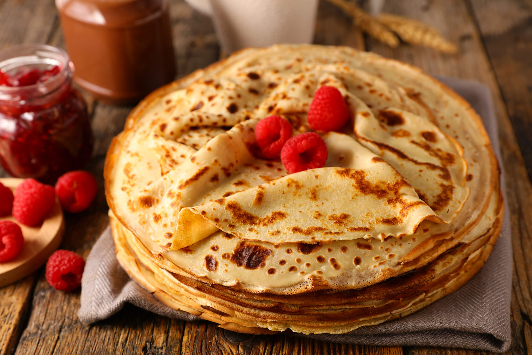 Stack of crepes with raspberries on top