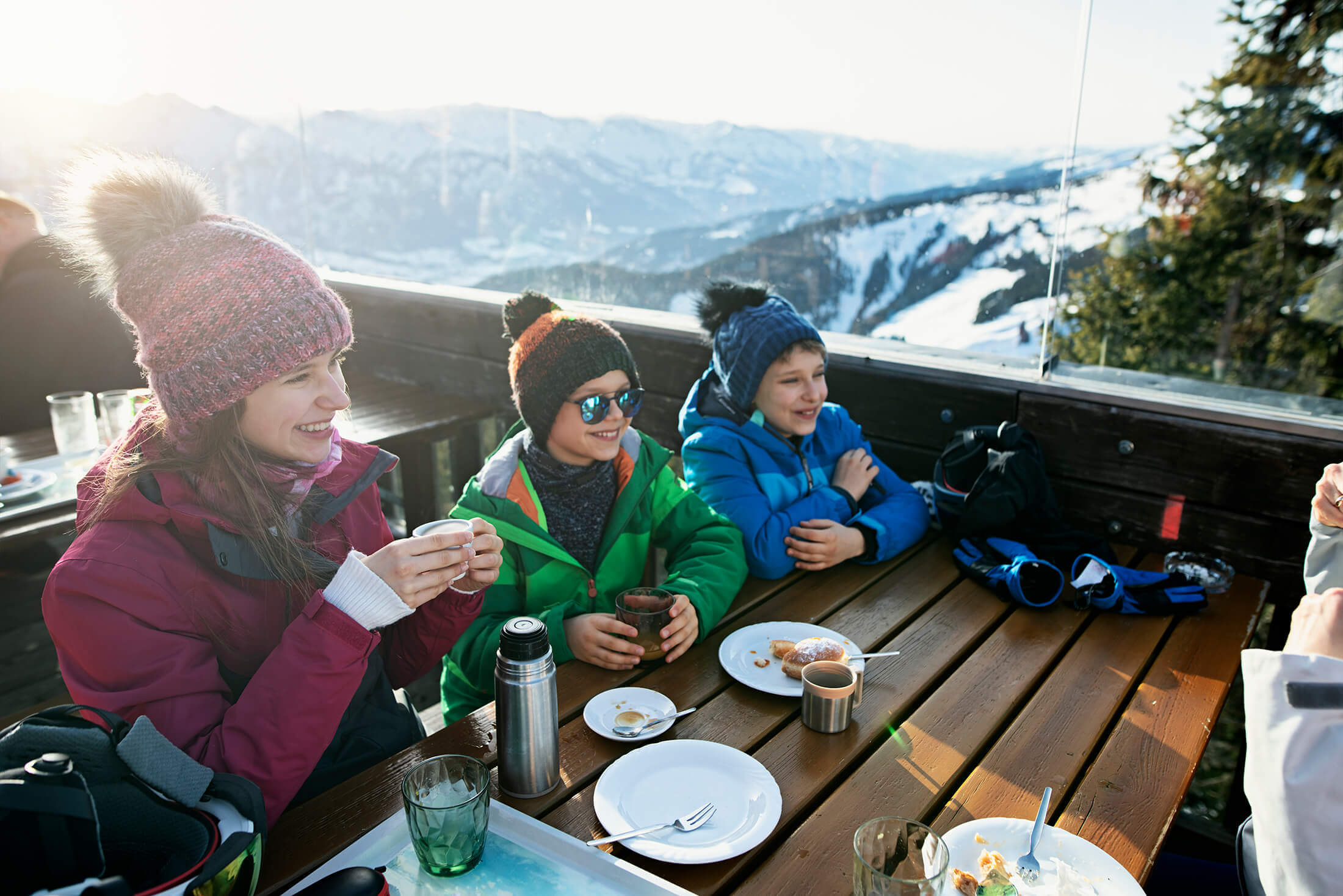 Family eating outside in the winter